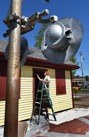 BRYAN EATON/Staff photo. Rick Fahey paints the Salisbury Point Station on Monday morning as Amesbury gets ready for its 350th anniversary celebration. The railroad station, built in 1870, was on Rocky Hill Road at the location of the Amesbury Riverwalk trail, and served the nearby Lowell's Boat Shop with receiving raw supplies and sending dory shipments.