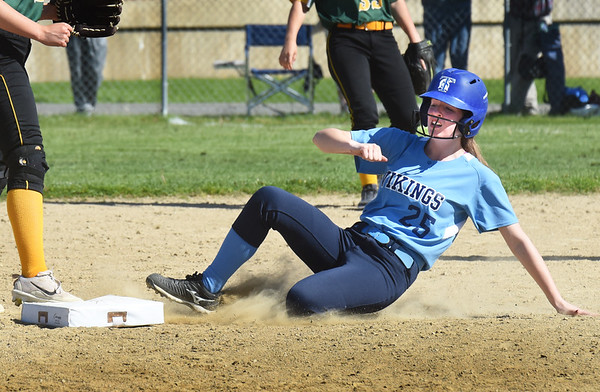 BRYAN EATON/Staff photo. Triton's #25 makes it to second as her teammate was tagged out at first.