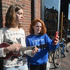 "JIM VAIKNORAS/Staff photo Ipswich high students Zoie Connelly and Erica Prisby perform The Everly Brothers ""All I have to Do is Dream"" on teh corner of State Street and Liberty Street in Newburyport."