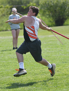 JIM VAIKNORAS/Staff photo Ipswich's Cole Schildkraut throws the javelin in the Cape Ann League Track and Field championships at Mascomonet in Boxford Saturday.