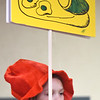 JIM VAIKNORAS/Staff photo Della Hildt, 10, hold a Green Eggs and Ham sign in the Amesbury Community Theatre's production of Seussical the Musical.