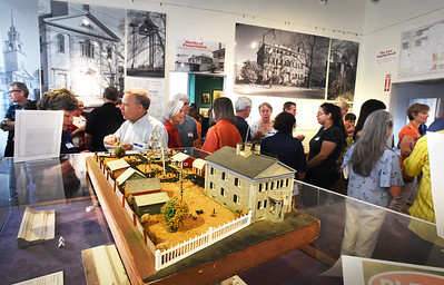 """BRYAN EATON/Staff photo. A reception was held Sunday afternoon capping the end of Preservation Week, by the Newburyport Preservation Trust, at the Custom House Maritime Museum, a model of which is in the foreground. The keynote presentation, """"Bartlett Mall: History, Significance and Preservation"""" was held Saturday at the Newburyport Superior Courthouse."""