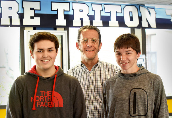 BRYAN EATON/Staff photo. Joseph Luciano, 16, left, and Benjamin Campbell, 15, right, with teacher Richard Fisher, placed first and second out of almost 900 students in the Securities Industry and Financial Markets Association stock market game.