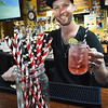BRYAN EATON/Staff photo. Plum Island bartender Eric Philcrantz and other staff are now using paper straws for adult and well as children's drinks. The owners like, other restaurateurs, are abandoning the use of plastic straws.