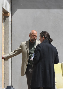 JIM VAIKNORAS/Staff photo Developer David Hall demonstrates an insulated door with Sen. Kathleen O'Connor Ives in a prototype building at the ground breaking of Hillside Center for Sustainable Living in Newburyport Friday.