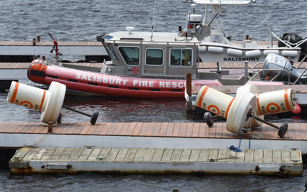 """BRYAN EATON/Staff photo. The office of the Salisbury Harbormaster has been busy getting ready for summer putting in docks and their craft at the town pier on Ring's Island. """"No Wake"""" buoys lay on one dock soon to be placed in areas of the Merrimack River."""