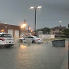 Effingham Police cars are surrounded by water near the Effingham Massage Clinic Wednesday evening. Amanda Bohnhoff Haynes photo