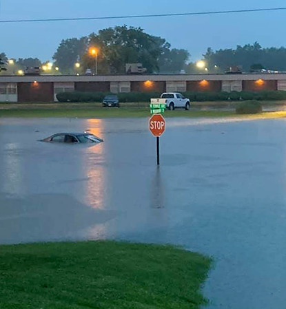 A car is submerged in the flood waters at the intersection of W. Temple Ave. and N. Mulberry St. in Effingham Wednesday night. Ethan Miller photo