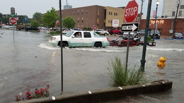 A truck pulls a trailer through waters at Washington and North Banker. Dawn Schabbing photo
