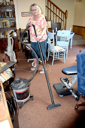 Jane Ries continues to suck up water from the carpeting in her basement after heavy rainfall caused water to come into the home. Dawn Schabbing photo