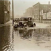 A vehicle passes through the flooded intersection of N. Banker and Washington Ave. in this photo from March 18, 1933. Submitted photo