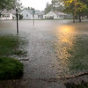Rising flood waters flow up to the yard of Hope Moore's Effingham home Wednesday evening. Hope Moore photo