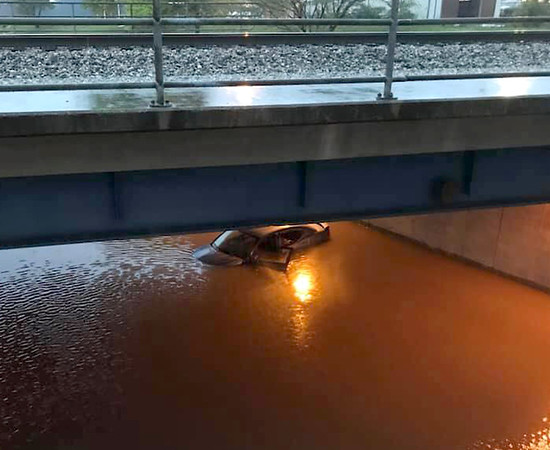 A closer look at the vehicle submerged in flood waters on the Fayette Ave. underpass Wednesday evening. Jon and Lisa Schafer photo