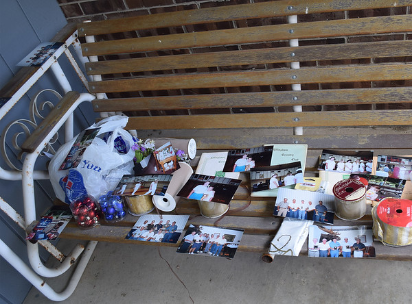 Items such as photos and other things lay out to dry since the flooding of the Mark and Jane Ries' basement. Dawn Schabbing photo