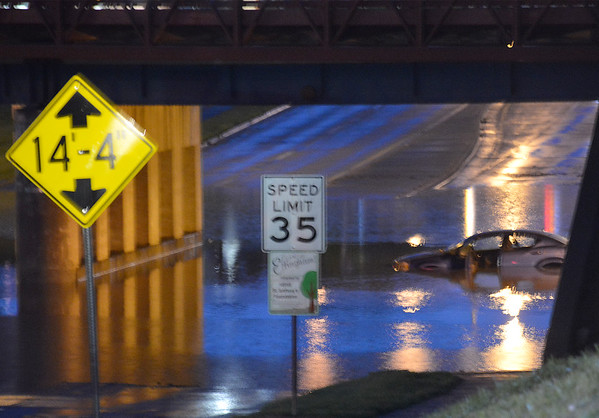 A car was stranded in flood waters at the Fayette Ave. underpass Wednesday night in Effingham. Kaitlin Cordes photo