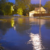 Flood waters lap over the intersection of Old S. Maple St. and South Maple St. in Effingham Wednesday night after a system dumped excessive amounts of rain on the area. Kaitlin Cordes photo