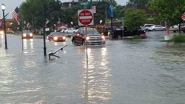 More vehicles make the way through flooded Washington Avenue, Effingham. Dawn Schabbing photo