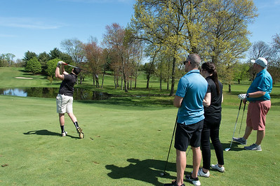 05/6/19  Wesley Bunnell | Staff  Ryan Gaffney, L, hits a shot on the 16th hole at Stanley Golf Course on Monday afternoon as Jonathan Botelho, Courtney Vinchesi and Dan Dyer look on.