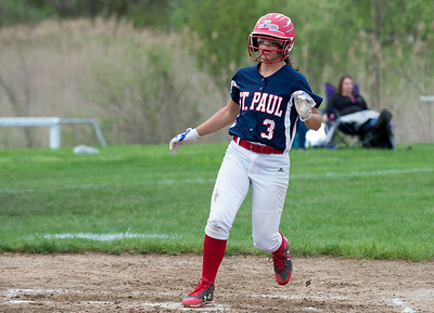 05/6/19  Wesley Bunnell | Staff  St. Paul Catholic softball vs Torrington on Senior Day on Monday afternoon. McKenzie Gauthier (3) scores a run for St. Paul.
