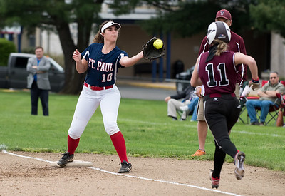 05/6/19  Wesley Bunnell | Staff  St. Paul Catholic softball vs Torrington on Senior Day on Monday afternoon. Rebecca Nerbonne (10) receives the throw to first in time.