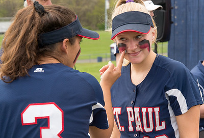 05/6/19  Wesley Bunnell | Staff  St. Paul softball players McKenzie Gauthier, (3) applies red and blue grease to Hannah Orzell (13) prior to their game on Monday afternoon.