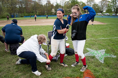 05/6/19  Wesley Bunnell | Staff  St. Paul Catholic softball vs Torrington on Senior Day on Monday afternoon. Katrina Roy (20) has a muscle cramp worked on by the trainer as teammate Ave Dunleavy mugs for the camera.