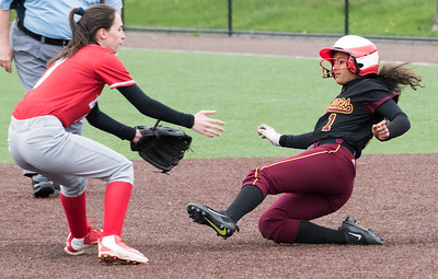 04/29/19  Wesley Bunnell | Staff  New Britain softball defeated Conard at Chesley Park on Monday afternoon. Josleen Rivera (1) slides into second base.