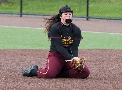04/29/19  Wesley Bunnell | Staff  New Britain softball defeated Conard at Chesley Park on Monday afternoon. Makaila Masterson (8) drops to her knees for a tough infield catch between 1st and second base.