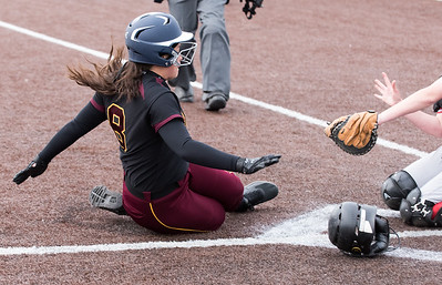 04/29/19  Wesley Bunnell | Staff  New Britain softball defeated Conard at Chesley Park on Monday afternoon. Makaila Masterson (8) slides into home for a run.