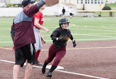 04/29/19  Wesley Bunnell | Staff  New Britain softball defeated Conard at Chesley Park on Monday afternoon. Amanda Jacobs is waved around third base and home to score a run.