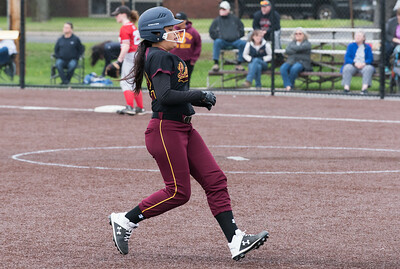 04/29/19  Wesley Bunnell | Staff  New Britain softball defeated Conard at Chesley Park on Monday afternoon. Paola Martinez cruises into 3rd base.