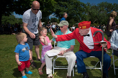 05/27/19  Wesley Bunnell | Staff  Bristol held Memorial Day ceremonies on Monday morning ending with a ceremony which presented World War II veterans with All Heart Awards from the city. Margaret McNamara, age 3, great granddaughter of veteran and award recipient Antonio Benvenuto, prepares to high five veteran and award recipient George Burns as her little brother Cyrus McNamara, age 1, looks on.