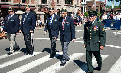 "05/27/19  Wesley Bunnell | Staff  Veterans and members of the American Legion Post 72 march down Main St during Monday mornings Memorial Day Parade including Louis Urso, R who served one year in Vietnam.  His medals include the Purple Heart and Bronze Star with V to indicate ""participation in acts of heroism involving conflict with an armed enemy."""