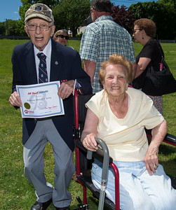 05/27/19  Wesley Bunnell | Staff  Bristol held Memorial Day ceremonies on Monday morning ending with a ceremony which presented World War II veterans with All Heart Awards from the city.  Veteran Anthony Sileo shows his award as he poses for a photo with his wife Jennie Sileo.