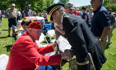 05/27/19  Wesley Bunnell | Staff  Bristol held Memorial Day ceremonies on Monday morning ending with a ceremony which presented World War II veterans with All Heart Awards from the city.  Veteran and award recipient George Burns, L, shakes hands with Commissioner Thomas Saadi, Esq. from the Department of Veterans Affairs.
