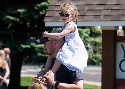 05/27/19  Wesley Bunnell | Staff  A young girl sitting on a adults shoulders so she can get a better look at the Southington Memorial Day Parade on Main St on Monday morning.