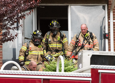 05/10/19  Wesley Bunnell | Staff  New Britain Fire Department, assisted by Bristol, Hartford and Meriden, responded to a fire in an apartment building at 180 Allen St on Friday afternoon which appeared to be located on the third floor. Firefighters remove their gear after exiting the building.