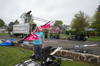 05/10/19  Wesley Bunnell | Staff  Vinny Biscoglio , a volunteer for the Race in the Park, assembles equipment at the start/finish line on Friday afternoon in anticipation of Saturday's race.  The race is held yearly at Walnut Hill Park and benefits the Connecticut Breast Health Initiative.