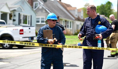 5/16/2019 Mike Orazzi | Staff Plainville Fire Marshall Larry Sutherland and fire inspector Ronald Dievert at a house fire on Fairbanks Street in Plainville Thursday morning. One person was rescued and eventually flown to the Bridgeport Burn Center at Bridgeport Hospital. Crews from several surrounding towns responded as mutual aid.