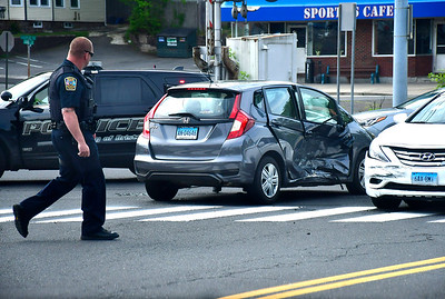 5/17/2019 Mike Orazzi | Staff The scene of a two-car crash at the intersection of Farmington and Burlington Avenue Friday morning. At least one was transported from the scene and both cars were towed.