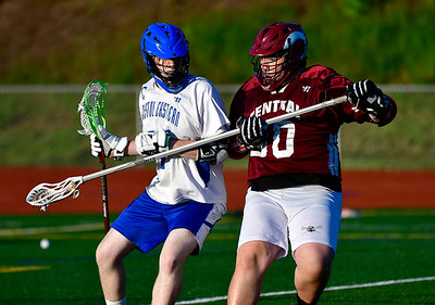5/16/2019 Mike Orazzi | Staff Bristol Central's Nathan Morton (30) and Bristol Eastern's Ethan Mathieu (27) during lacrosse at Eastern Thursday evening.