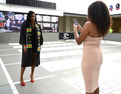 5/18/2019 Mike Orazzi | Staff CCSU graduate Shanese Mims and her sister Aaliyah Mims on commencement day at the XL Center in Hartford on Saturday.