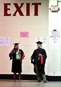 5/18/2019 Mike Orazzi | Staff CCSU graduates Phylicia Ward and Ryan Gregory on commencement day at the XL Center in Hartford on Saturday.