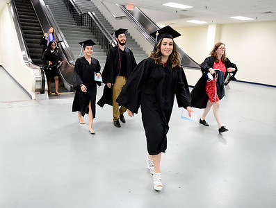 5/18/2019 Mike Orazzi | Staff CCSU graduates arrive on commencement day at the XL Center in Hartford on Saturday.