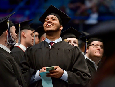 5/18/2019 Mike Orazzi | Staff CCSU graduate Saleh Syed on commencement day at the XL Center in Hartford on Saturday.