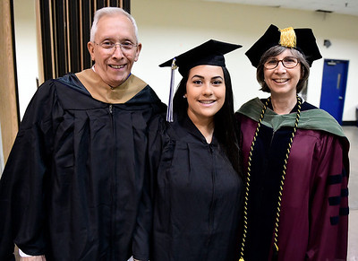 5/18/2019 Mike Orazzi | Staff CCSU's Rich and Jan Bishop with their daughter Olivia on commencement day at the XL Center in Hartford on Saturday.