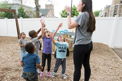 05/20/19  Wesley Bunnell | Staff  Teacher Emma Wade blows bubbles for her students to catch as Jesiah Padua reaches with her arms outstretched during the New Britain YMCA School Readiness program on Monday afternoon's recess.