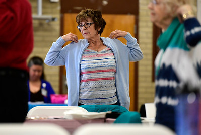 5/2/2019 Mike Orazzi | Staff Jean Dye does a stretching exercise during the CTridads program held at the Bristol Senior Center on Thursday morning.