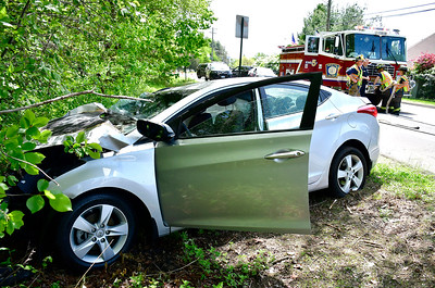 5/22/2019 Mike Orazzi | Staff Bristol Police are looking for a pickup truck believed to possibly be involved in a chaotic series of car crashes on Mix Street late Wednesday morning involving three other vehicles, including one that went off the road and into a tree, sending one woman to the hospital. A Hyundai Elantra lost its rear, passenger side wheel when it was reportedly hit by another vehicle and sent off the road and into a tree, catching on fire across from the Giamatti Little League Center around 11:30 a.m. The car left skid marks indicating it went at least 20 yards with only one back wheel before it left the road