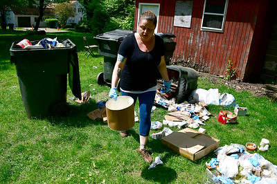5/22/2019 Mike Orazzi | Staff Jessica Huppenbauer cleans up after three bears were in the area of Clevelands' Country Store in Plymouth Wednesday.